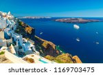 oia town on santorini island ... | Shutterstock . vector #1169703475