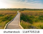footpath to the sea at the... | Shutterstock . vector #1169705218