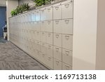 Stock photo row of white office filing cabinets 1169713138