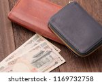 Small photo of Old wallet and Japanese 2,000 yen bill
