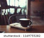 coffee latte in coffee shop cafe | Shutterstock . vector #1169755282