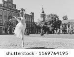 ballerina dancing on the street.... | Shutterstock . vector #1169764195