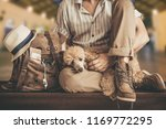 young man with dog and backpack ... | Shutterstock . vector #1169772295