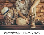 young man with backpack .... | Shutterstock . vector #1169777692