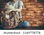 young woman with backpack .... | Shutterstock . vector #1169778778