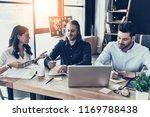 brainstorming together. group... | Shutterstock . vector #1169788438
