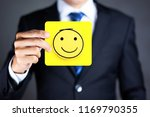 businessman hold a happy face... | Shutterstock . vector #1169790355