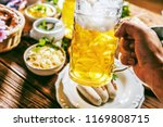 oktoberfest beer  pretzels and... | Shutterstock . vector #1169808715