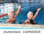 sportive senior couple doing... | Shutterstock . vector #1169832025