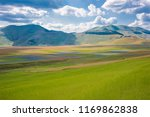 valley with flower fields among ... | Shutterstock . vector #1169862838