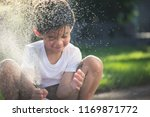 cute asian boy has fun playing... | Shutterstock . vector #1169871772