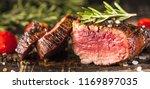 fresh fillet steak  | Shutterstock . vector #1169897035
