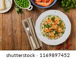 risotto with shrimp. top view.... | Shutterstock . vector #1169897452