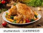 roast chicken whole. served on... | Shutterstock . vector #1169898535