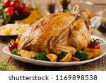 roast chicken whole. served on... | Shutterstock . vector #1169898538