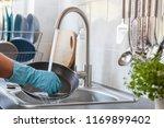 washing dishes. washing pan. | Shutterstock . vector #1169899402
