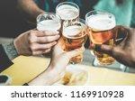 group of friends enjoying a... | Shutterstock . vector #1169910928