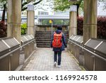 young woman with backpack in...   Shutterstock . vector #1169924578