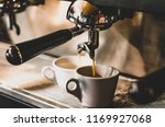 Stock photo close up of espresso pouring from coffee machine professional coffee brewing 1169927068