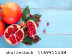 ripe pomegranate fruits on the... | Shutterstock . vector #1169955538