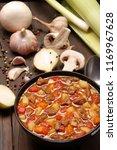 beef stew in black bowl on wood ... | Shutterstock . vector #1169967628