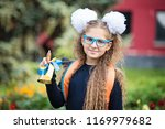portrait of a beautiful young... | Shutterstock . vector #1169979682
