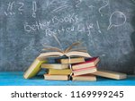 a pile of books and an open... | Shutterstock . vector #1169999245