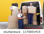 male movers unloading boxes... | Shutterstock . vector #1170001915