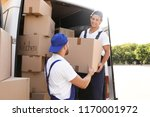 male movers unloading boxes... | Shutterstock . vector #1170001972