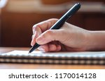 closeup image of a hand writing ... | Shutterstock . vector #1170014128