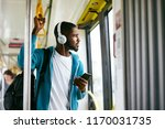 man using phone  listening... | Shutterstock . vector #1170031735