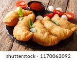 fried panzerotti with a filling ... | Shutterstock . vector #1170062092