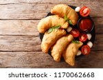 fried panzerotti with a filling ... | Shutterstock . vector #1170062668