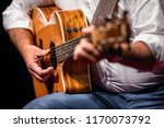 man playing a guitar on stage ... | Shutterstock . vector #1170073792