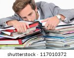 man drowning in stacks of...   Shutterstock . vector #117010372
