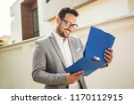 young businessman looking on... | Shutterstock . vector #1170112915