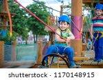 little cute boy enjoying... | Shutterstock . vector #1170148915