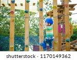 brave little boy having fun at... | Shutterstock . vector #1170149362