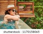 woman in luxury hotel staying...   Shutterstock . vector #1170158065