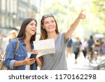 two happy tourists sightseeing... | Shutterstock . vector #1170162298