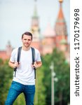 young smilling man hiking... | Shutterstock . vector #1170179698