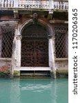 old door in venice  italy....   Shutterstock . vector #1170206365