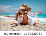 happy young family with little... | Shutterstock . vector #1170230752
