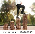 businessman walk on stack of... | Shutterstock . vector #1170286255