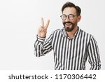 peace. attractive adult man... | Shutterstock . vector #1170306442