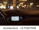 the car with the navigator is... | Shutterstock . vector #1170307048