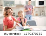 little girl with mother doing... | Shutterstock . vector #1170370192