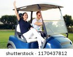 couple smiling and driving in... | Shutterstock . vector #1170437812