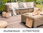 wicker patio set with beige... | Shutterstock . vector #1170474232