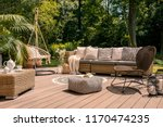 a rattan patio set including a... | Shutterstock . vector #1170474235